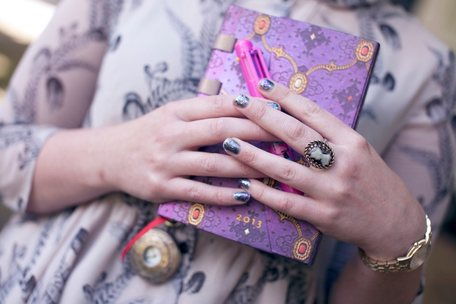 A close-up of Charlotte's gorgeous jewellery & nails