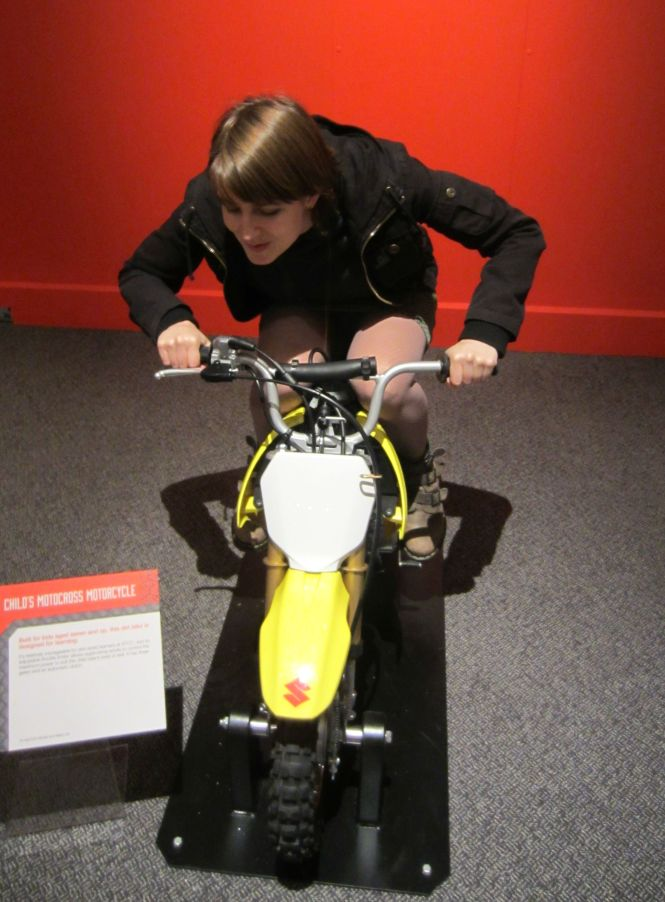 Me on the child's bike.  :D