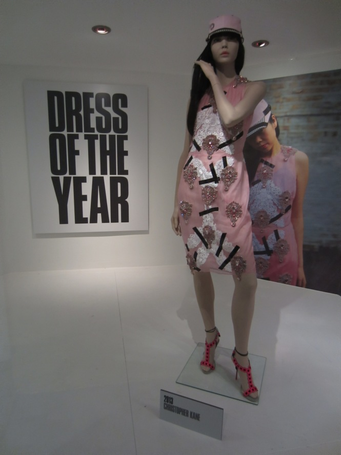 Really?  This was the dress of the year for 2013?  With a matching Baseball cap?  *i just threw up a little in my mouth*