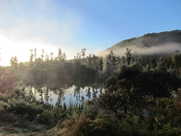 Early morning fog lifting over Lake Monowai